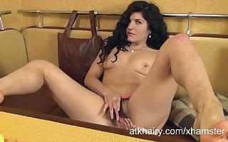 Markiza masturbates her furry pussy in a go aboard booth