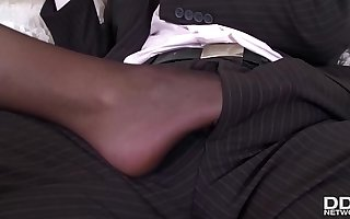 Foot fetish porn with honcho British babe Emma Leigh in thigh high pantyhose